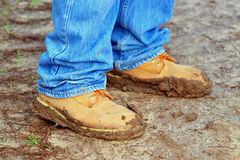 Walking Shoes Coated with Mud. Trekking shoes coated with mud after a walking trip on a winters day Royalty Free Stock Photography