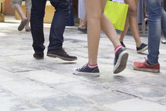 Walking in shoes on pavement in park Royalty Free Stock Image