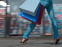 Walking shopping woman holding bag Royalty Free Stock Photography