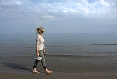 Walking the Shoreline Royalty Free Stock Photo