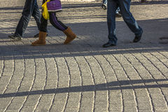 Walking on sidewalk Stock Photos