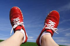 Walking the Sky. Red boots in front of sky Royalty Free Stock Images