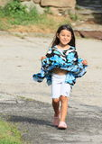 Walking smiling little girl Royalty Free Stock Image