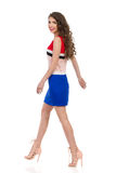 Walking Smiling Woman In Mini Dress And High Heels Stock Photo