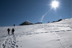 Walking on snow. Hiking in the snow in the Alps Stock Photo