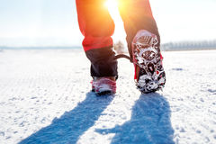 Walking on snow with Snow shoes and Shoe spikes in winter. View of walking on snow with Snow shoes and Shoe spikes in winter Stock Image