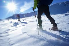 Walking in a snowshoes on a mountain snowy plateau Royalty Free Stock Images