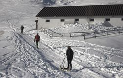 Walking in the snowy mountain royalty free stock images