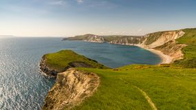 Worbarrow Bay, Jurassic Coast, Dorset, UK. Walking on the South West Coast Path, looking at Worbarrow Bay, near Tyneham, Jurassic Coast, Dorset, UK Royalty Free Stock Photography