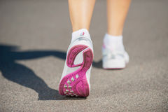 Walking in sports shoes. Stock Image