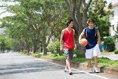 Walking sportsmen Royalty Free Stock Images