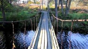 Walking steadily on the hanging bridge stock video footage