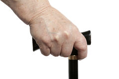 Walking stick aid. Senior lady hand with walking stick, isolated Royalty Free Stock Photos