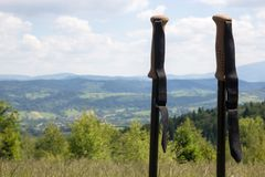 Walking sticks against a mountain landscape stock photos