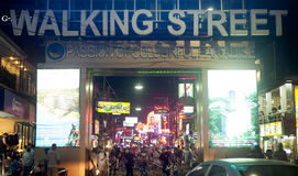 Walking street. PATTAYA, THAILAND - MARCH 13: Nightlife on walking street on March, 2012 in Pattaya. Walking Street  is a popular tourist attraction.  It is a Royalty Free Stock Photography