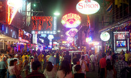 Walking street. PATTAYA, THAILAND - MARCH 13: Nightlife on walking street on March, 2012 in Pattaya. Walking Street  is a popular tourist attraction.  It is a Royalty Free Stock Photos