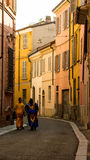 Walking on street. A colorful street Of A Feature Italian city where two women walking in african dresses Stock Photography