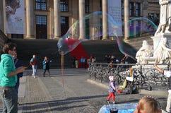 Berlin, Germany - November 03, 2014: Man makes big soap bubbles royalty free stock image
