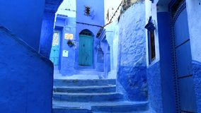 Walking in the street in old blue medina of the Chefchaouen City, Morocco