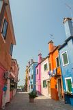 Walking through the streets of Burano. Colorful houses. Royalty Free Stock Photo