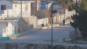 Walking in the Streets of Juarez, Mexico. Wide shot of a person walking through the streets of a neighborhood in Juarez, Mexico stock video