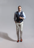 Walking suave stylish bearded man in classic vest Royalty Free Stock Images