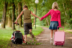 Walking with the suitcases back stock images