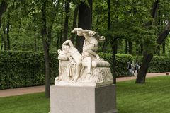 Sculptural group Cupid and Psyche. Walking through the Summer Garden of St. Petersburg in cloudy, rainy weather Royalty Free Stock Photo