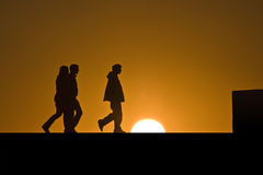 Walking on the sun. Emotional image, backlighting and silhouettes royalty free stock images