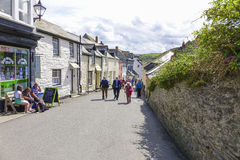 Walking in the sun in Port Issac on a hot sunny summers afternoon Stock Photography
