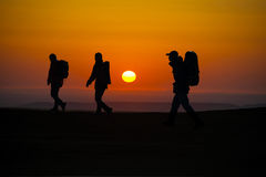 Walking in the sunglow hikers Royalty Free Stock Image
