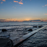 Walking into the sunset 01. Panoramic sunset on the Tuscany sea in front of Leghorn royalty free stock photography