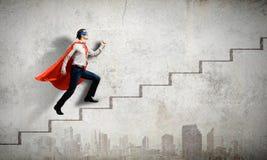 Walking superhero Royalty Free Stock Images