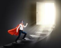 Walking superhero Royalty Free Stock Image