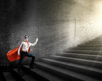 Walking superhero Royalty Free Stock Photography