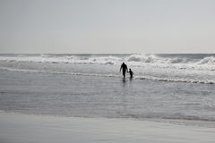 Walking in surf Stock Photography