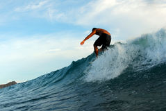 Walking on a Surfboard. A surfer surfing in beautiful Hawaii, walking to the nose of his board Stock Images