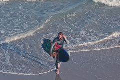 Walking surfer stock images