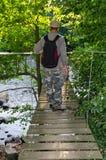 Walking on suspension bridge Royalty Free Stock Photos