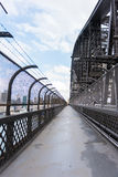 Walking on the Sydney Harbour Bridge in Sydney, Australia. People walking and running on the popular pedestrian walkway on the Sydney Harbour Bridge in Australia Stock Photo