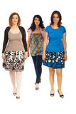 Walking three women. Three women walking isolated on white background royalty free stock photography