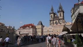 Walking thru international tourist crowd on Prague Old Town Square stock video footage
