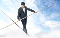 Walking a tightrope Royalty Free Stock Images