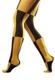 Walking on tiptoe. Legs of a woman in checkered pantyhose walking on tiptoe Stock Image