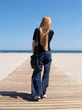 Walking to the beach. Woman walking to the beach Royalty Free Stock Image