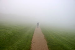Walking in to the mist Royalty Free Stock Photo