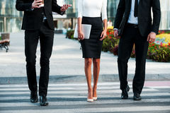 Walking to success. Cropped image of three business people crossing the street Royalty Free Stock Image