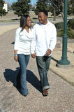 Walking Together. Young and attractive black couple in a park walking and holding hands Stock Photography