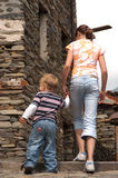 Walking together. Brother ans sister walking together Royalty Free Stock Image
