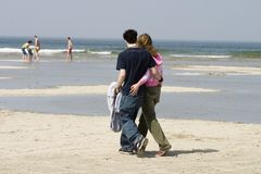 Walking together. Couple walking on the beach royalty free stock photos